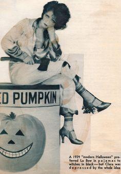 Clara Bow sitting on canned pumpk