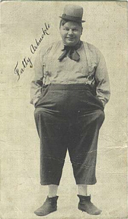 Arbuckle standing in costume