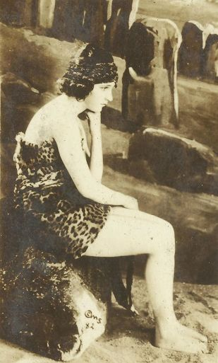 Sybil as bathing beauty seated