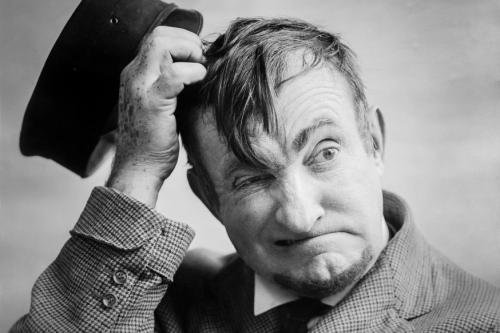 Charlie Murray head scratch